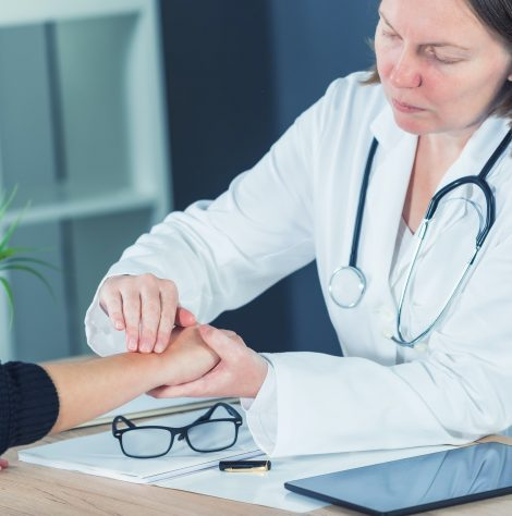 female-patient-at-orthopedic-doctor-medical-exam-for-wrist-injur.jpg